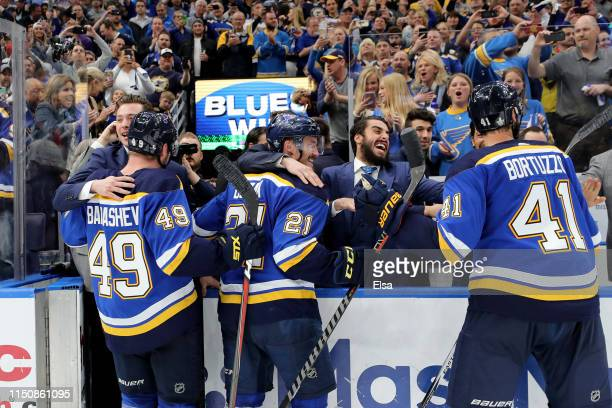 Ivan Barbashev Tyler Bozak and Robert Bortuzzo of the St Louis Blues celebrate after defeating the San Jose Sharks in Game Six with a score of 5 to 1...