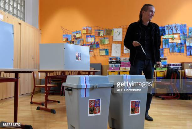 Ivan Bartos chairman of the Czech pirate Party casts his ballot at a polling station during the first day of voting in the Czech elections on October...