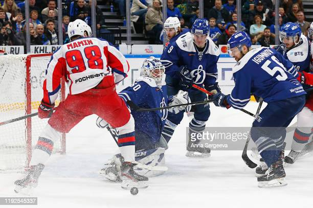 Ivan Bocharov of Dynamo Moscow makes a save against Maxim Mamin of CSKA Moscow during the first period of the Kontinental Hockey League between...