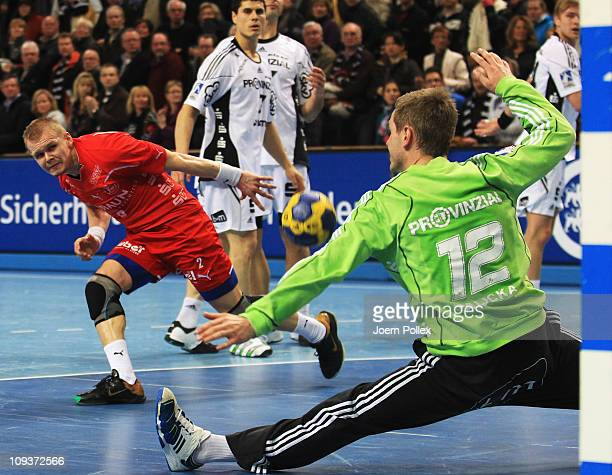 Ivan Brovka of Melsungen tries to score during the Toyota Handball Bundesliga match between THW Kiel and MT Melsungen at the Sparkassen Arena on...