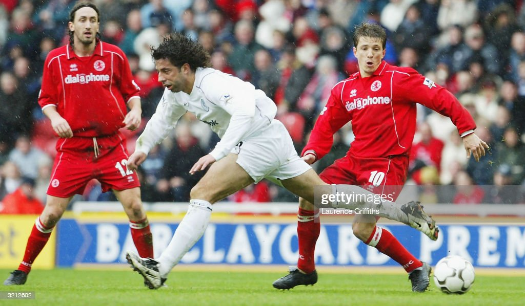 Ivan Campo of Bolton battles with Juninho of Boro during the FA Barclaycard Premiership match between Middlesbrough and Bolton Wanderers at The Riverside Stadium on April 3, 2004 in Middlesbrough, England.