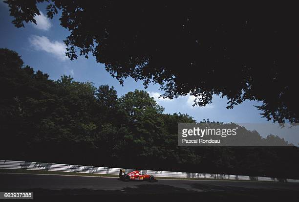 Ivan Capelli of Italy drives the Scuderia Ferrari SpA Ferrari F92A along the tree lined forest section of the circuit during the Mobil 1 German Grand...