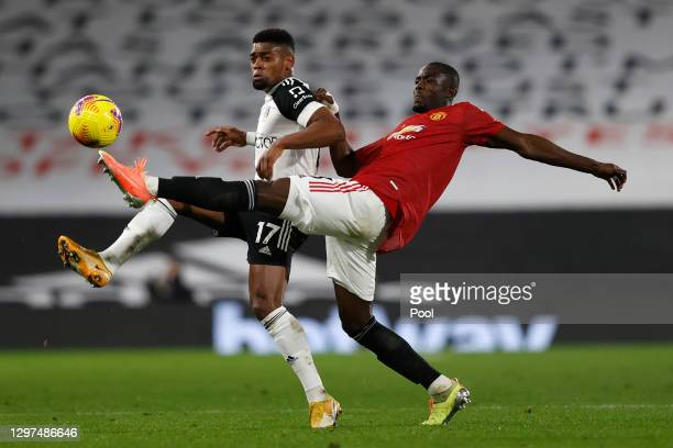 Ivan Cavaleiro of Fulham and Eric Bailly of Manchester United battle for possession during the Premier League match between Fulham and Manchester...