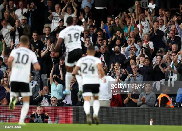 Ivan Cavaleiro of Fulham celebrates in front of the Fulham fans after scoring the opening goal during the Sky Bet Championship match between Fulham...