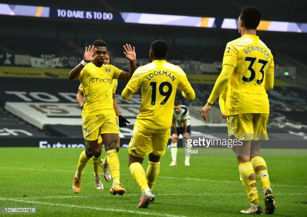 Ivan Cavaleiro of Fulham celebrates with teammate Ademola Lookman after scoring their team's first goal during the Premier League match between...