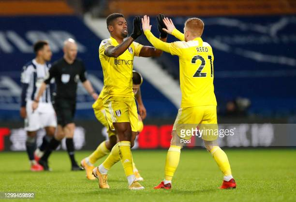 Ivan Cavaleiro of Fulham celebrates with teammate Harrison Reed after scoring their side's second goal during the Premier League match between West...