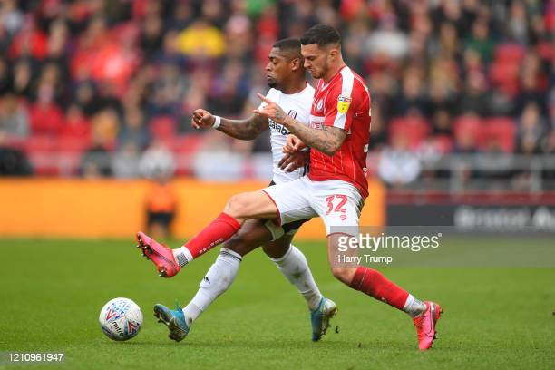 Ivan Cavaleiro of Fulham is challenged by Pedro Pereira of Bristol City during the Sky Bet Championship match between Bristol City and Fulham FC at...