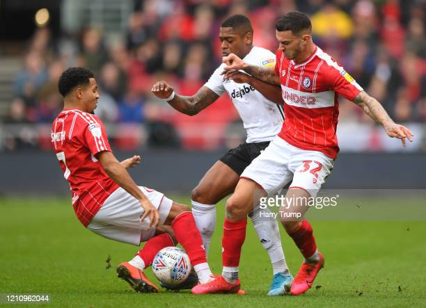 Ivan Cavaleiro of Fulham is tackled by Pedro Pereira and Korey Smith of Bristol City during the Sky Bet Championship match between Bristol City and...
