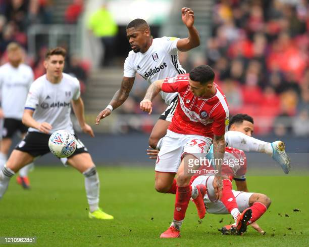 Ivan Cavaleiro of Fulham is tackled Pedro Pereira and and Korey Smith of Bristol City during the Sky Bet Championship match between Bristol City and...