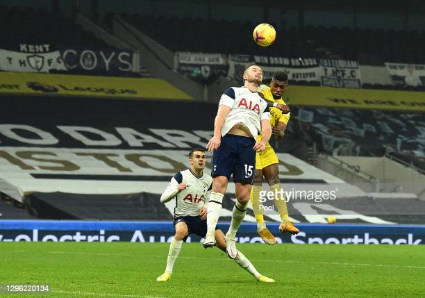 Ivan Cavaleiro of Fulham scores their team's first goal under pressure from Eric Dier of Tottenham Hotspur during the Premier League match between...
