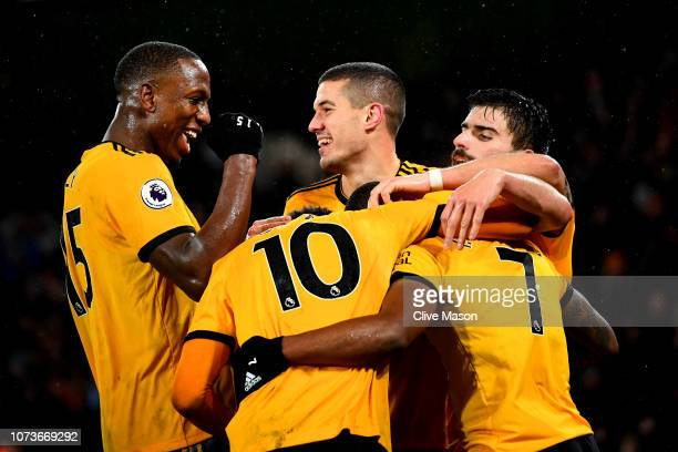 Ivan Cavaleiro of Wolverhampton Wanderers celebrates after scoring his team's second goal with his team mates during the Premier League match between...