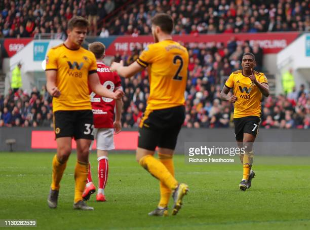 Ivan Cavaleiro of Wolverhampton Wanderers celebrates as he scores his team's first goal with Matt Doherty and Leander Dendoncker during the FA Cup...