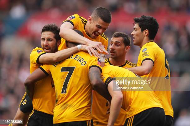 Ivan Cavaleiro of Wolverhampton Wanderers celebrates as he scores his team's first goal with Conor Coady and team mates during the FA Cup Fifth Round...