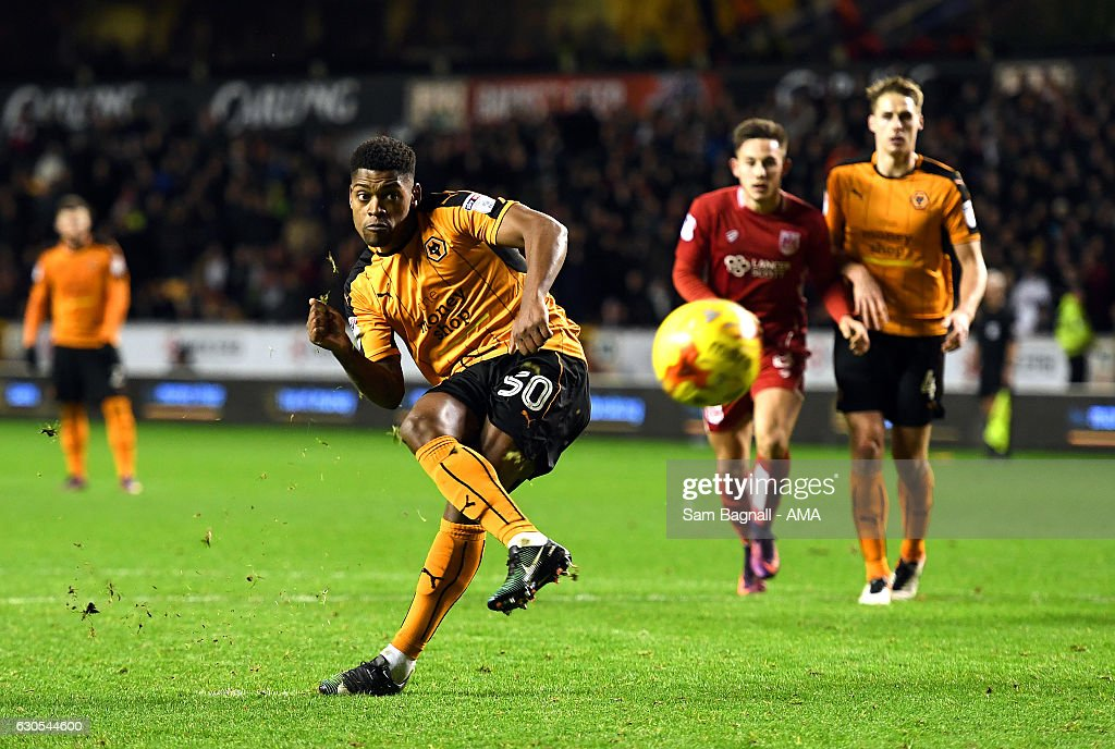Ivan Cavaleiro of Wolverhampton Wanderers scores a goal to make it 3-2 from a penalty kick from a penalty kick with Conor Coady of Wolverhampton Wanderers during the Sky Bet Championship match between Wolverhampton Wanderers and Bristol City at Molineux on December 26, 2016 in Wolverhampton, England.