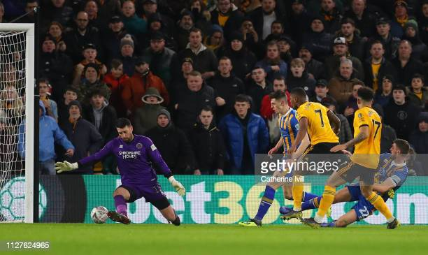 Ivan Cavaleiro of Wolverhampton Wanderers scores his side's third goal past Steve Arnold of Shrewsbury Town during the FA Cup Fourth Round Replay...