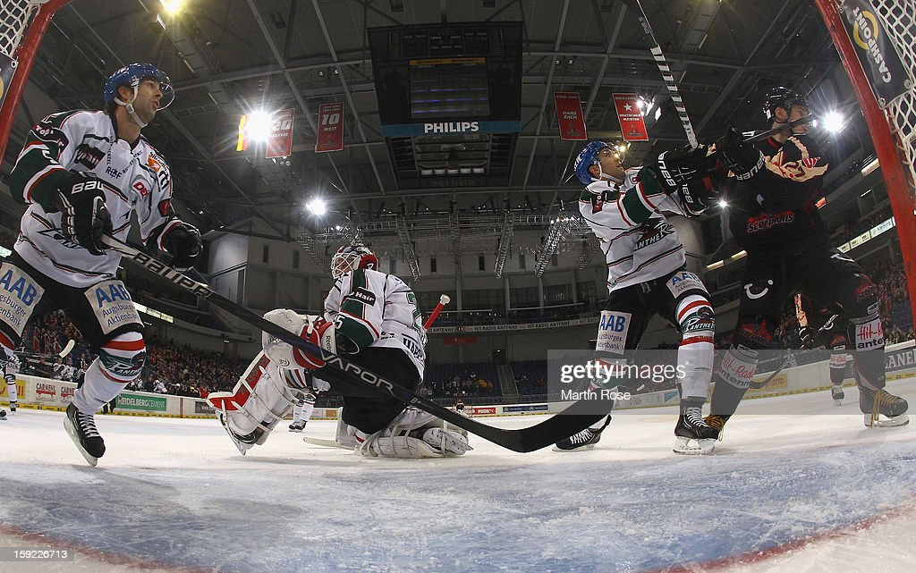 Ivan Ciernik (R) of Hannover battles for position with Justin Forrest (L) of Augsburg in front of the net during the DEL match between Hannover Scorpions and Augsburger Panther at TUI Arena at TUI Arena on January 9, 2013 in Hanover, Germany.