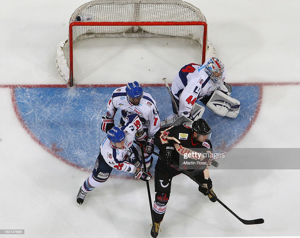 Ivan Clernik (R) of Hannover and James Sifers (L) of Mannheim battle for position in front of the net during the DEL match between Hannover Scorpions and Aadler Mannheim at TUI Arena on October 14, 2012 in Hanover, Germany.
