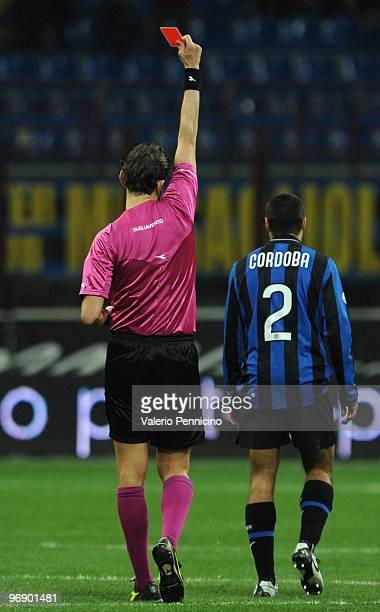 Ivan Cordoba of FC Internazionale Milano receives the red card from referee Paolo Tagliavento during the Serie A match between FC Internazionale...