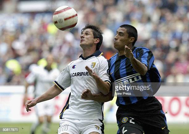 Ivan Cordoba of Inter Milan and Giuseppe Carbone of Parma tussle for the ball during the Serie A match between Inter Milan and Parma at the Guiseppe...