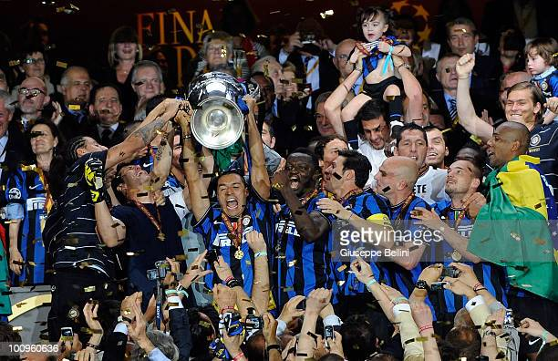 Ivan Cordoba of Inter Milan lifts the UEFA Champions League trophy following their team's victory at the end of the UEFA Champions League Final match...
