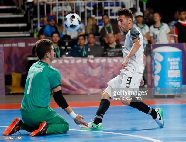 Ivan Corrales of Costa Rica has his shot attempt blocked by goalkeeper Alireza Sedigh of IR Iran in the Men's Futsal Group B match between Costa Rica...