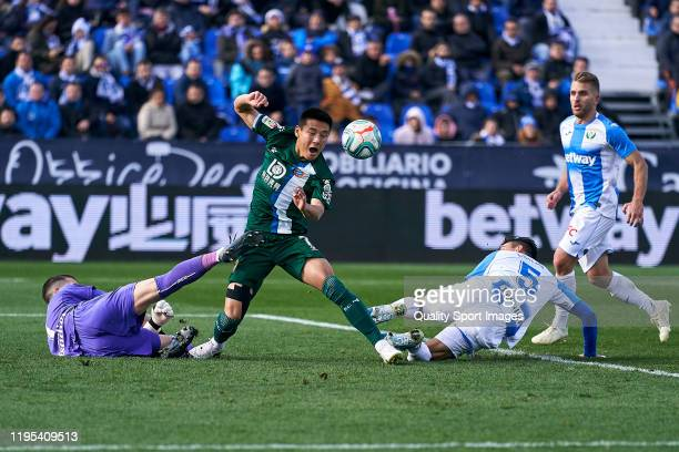 Ivan Cuellar of CD Leganes battles for the ball with Wu Lei of RCD Espanyol during the Liga match between CD Leganes and RCD Espanyol at Estadio...