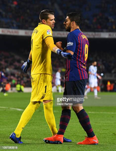 Ivan Cuellar of Leganes and Luis Suarez of Barcelona clash during the La Liga match between FC Barcelona and CD Leganes at Camp Nou on January 20...
