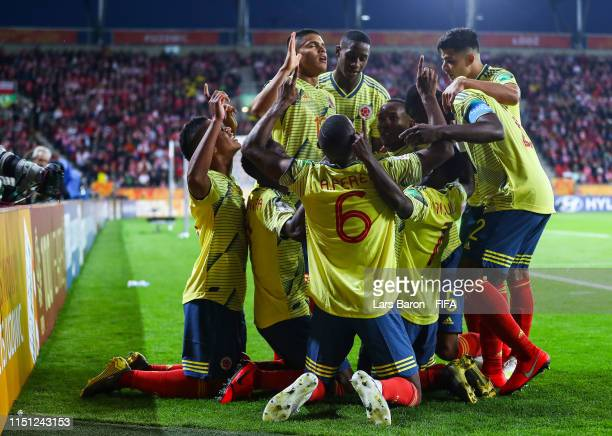 Ivan Dario Angulo Cortes of Colombia celebrates with his team mates after scoring his team's first goal during the 2019 FIFA U20 World Cup group A...