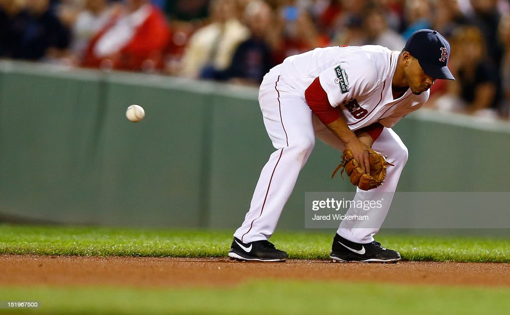 Ivan De Jesus #56 of the Boston Red Sox misplays a ground ball that goes between his legs against the New York Yankees during the game on September 13, 2012 at Fenway Park in Boston, Massachusetts.