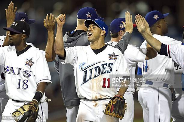 Ivan De Jesus of the Norfolk Tides celebrates with his International League teammates following a 73 victory against the Pacific Coast in the 2014...