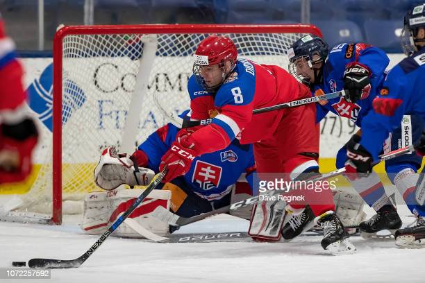 Ivan Didkovski of the U17 Russian Nationals battles for the puck with Marek Putala of the U17 Slovakia Nationals during day-2 of game one of the 2018...