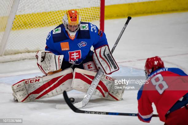 Ivan Didkovski of the U17 Russian Nationals scores a five hole goal on imon Latkóczy of the U17 Slovakia Nationals during day-2 of game one of the...