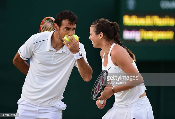 Ivan Dodic of Croatia and Ajla Tomljanovic of Australia in action during the Mixed Doubles First Round match against Marci Matkowski of Poland and...