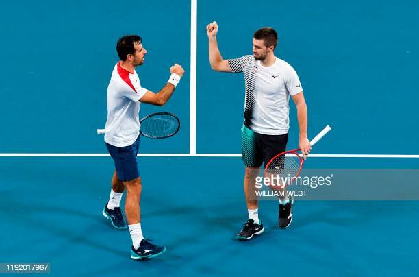 Ivan Dodig and Nikola Mektic of Croatia celebrate after winning a point in their doubles match against Hubert Hurkacz and Lukasz Kubot of Poland at...