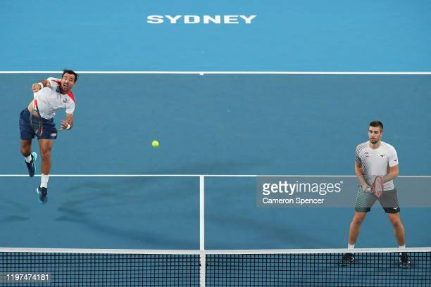 Ivan Dodig and Nikola Mektic of Croatia in action during their Group E doubles match against Oliver Marach and Jurgen Melzer of Austria during day...