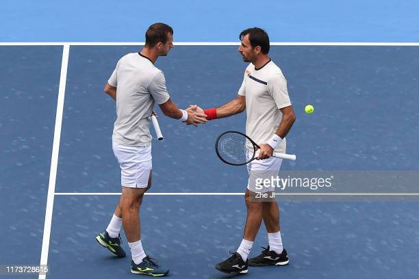 Ivan Dodig of Croatia and Filip Polasek of Slovakia celebrate after defeating Jamie Murray and Neal Skupski of Great Britain in their Men's doubles...