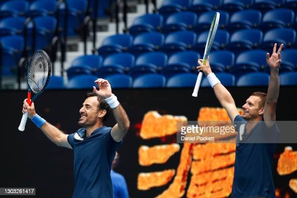 Ivan Dodig of Croatia and Filip Polasek of Slovakia celebrate after winning their Men's DoublesFinal match against Joe Salisbury of Great Britain...