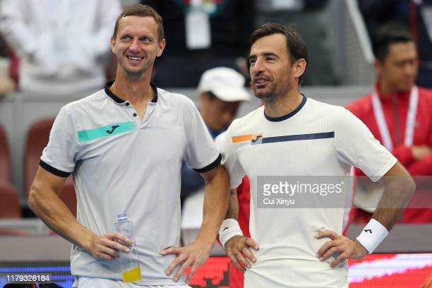 Ivan Dodig of Croatia and Filip Polasek of Slovakia celebrate during the award ceremony after their Men's doubles final match against Lukasz Kubot of...