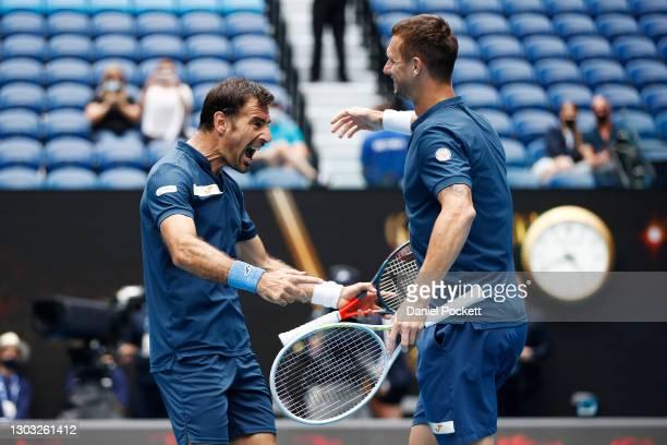 Ivan Dodig of Croatia and Filip Polasek of Slovakia celebrate winning championship point in their Men's DoublesFinal match against Joe Salisbury of...
