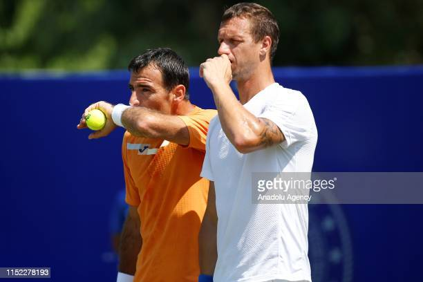 Ivan Dodig of Croatia and Filip Polasek of Slovakia in action against Igor Zelenay of Slovakia and Denys Molchanov of Ukraine during double's semi...
