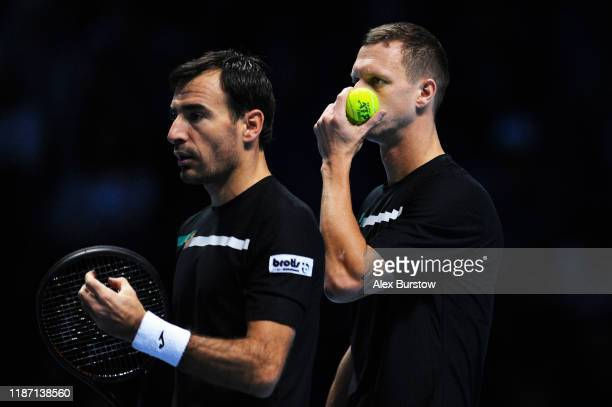 Ivan Dodig of Croatia and Filip Polasek of Slovakia prepare to serve in their doubles match against Joe Salisbury of Great Britain and Rajeec Ram of...