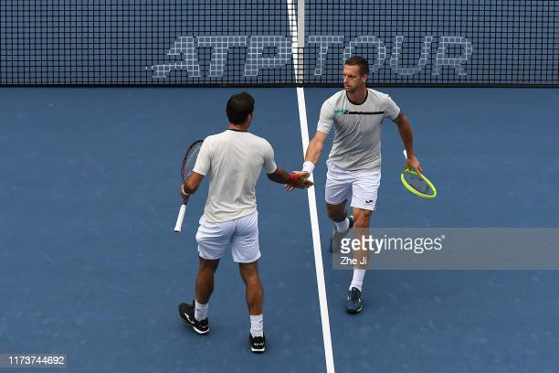 Ivan Dodig of Croatia and Filip Polasek of Slovakia react during their Men's doubles Semifinal match of 2019 China Open against Jamie Murray of Great...