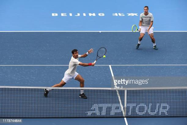 Ivan Dodig of Croatia and Filip Polasek of Slovakia return a shot during their Men's doubles Semifinal match of 2019 China Open against Jamie Murray...