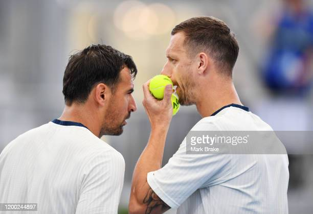 Ivan Dodig of Croatia and Filip Polasek of Slovakia talk tatics in their doubles final against Maximo Gonzalez of Argentina and Fabrice Martin of...