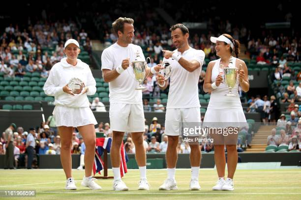 Ivan Dodig of Croatia and Latisha Chan of Chinese Taipei and Robert Lindstedt of Sweden and Jelena Ostapenko of Latvia pose with their trophies...
