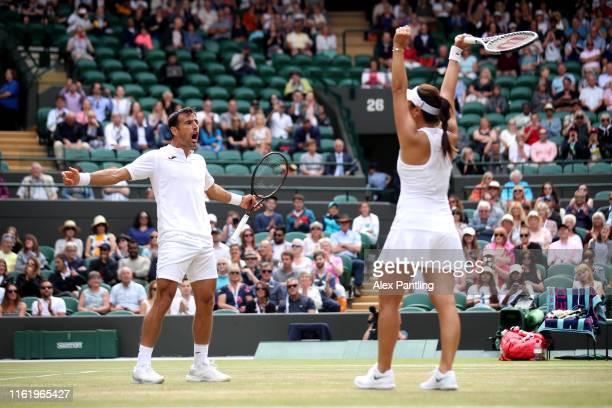 Ivan Dodig of Croatia and Latisha Chan of Chinese Taipei celebrate Championship point in their Mixed Doubles final against Robert Lindstedt of Sweden...