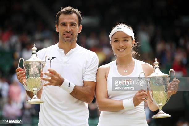 Ivan Dodig of Croatia and Latisha Chan of Chinese Taipei pose with the trophy following victory in their Mixed Doubles final against Robert Lindstedt...