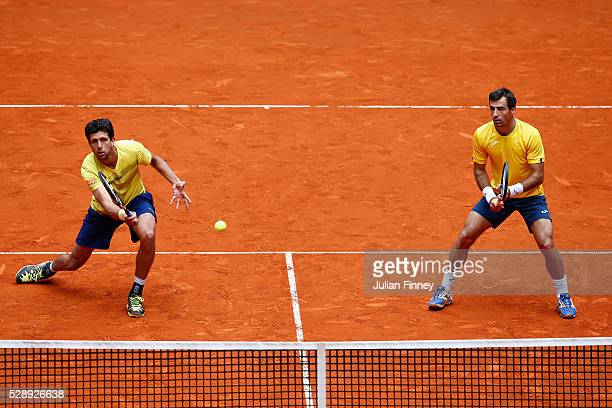 Ivan Dodig of Croatia and Marcelo Melo of Brazil in action against Rohan Bopanna of India and Florin Mergea of Romania in the doubles semi final...