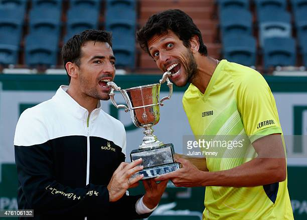 Ivan Dodig of Croatia and Marcelo Melo of Brazil pose with the trophy after winning the Men's Doubles Final against Mike Bryan of the United States...