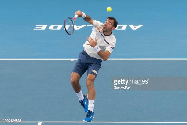 Ivan Dodig of Croatia hits an overhead ball in the men's doubles grand final with partner Filip Polasek of Slovakia against Fabrice Martin of France...
